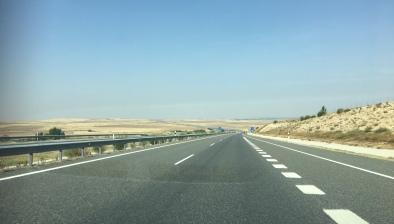 Barren lands, empty roads heading towards Portugal