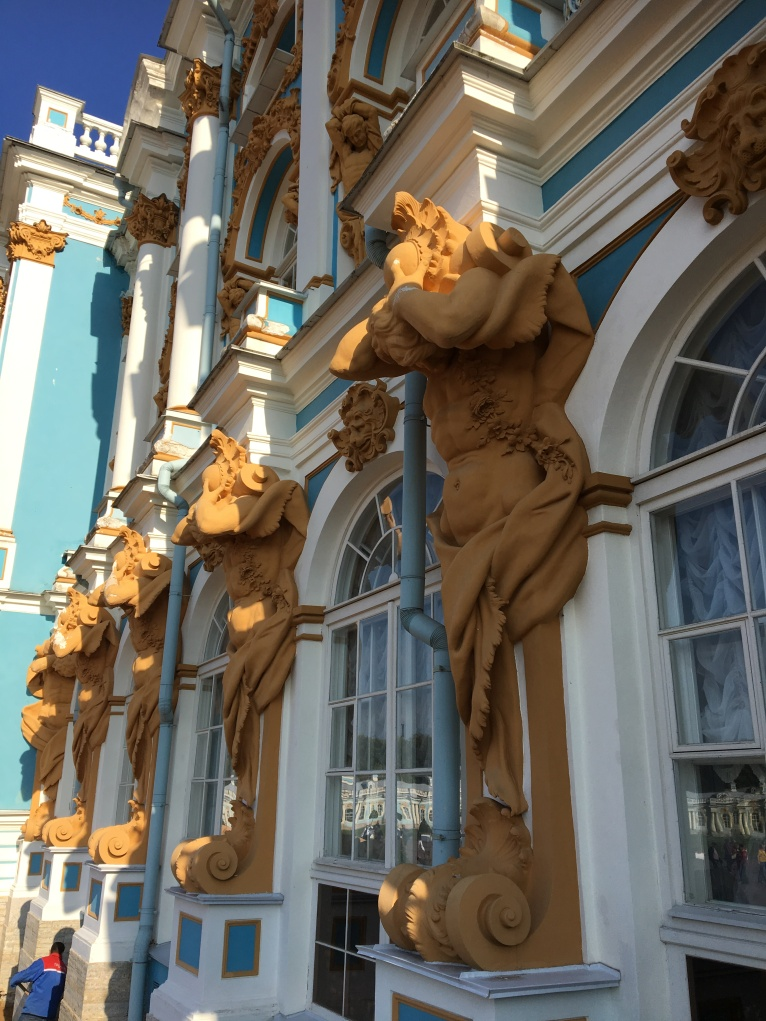 Palace facade detail, once these figures of Atlas were gold coated.
