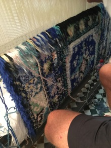 Observing the hand-knotted rugs being made
